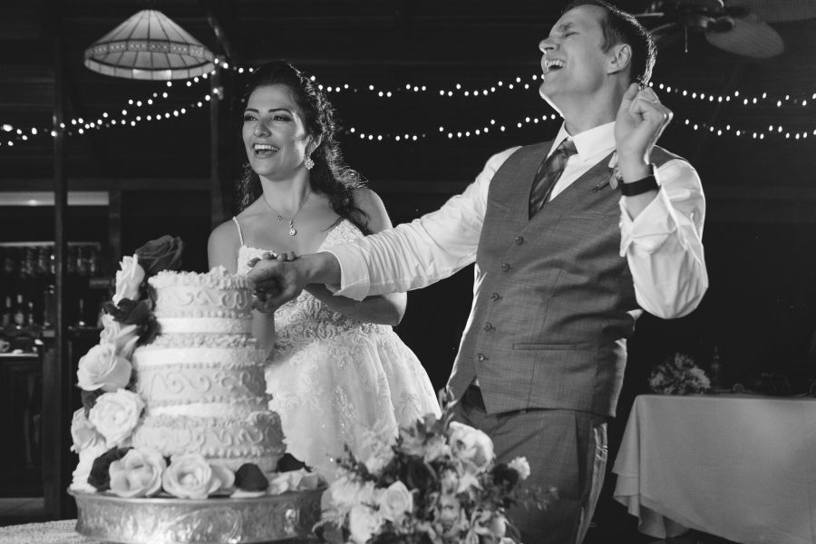 Bride and groom dance as they cut the cake