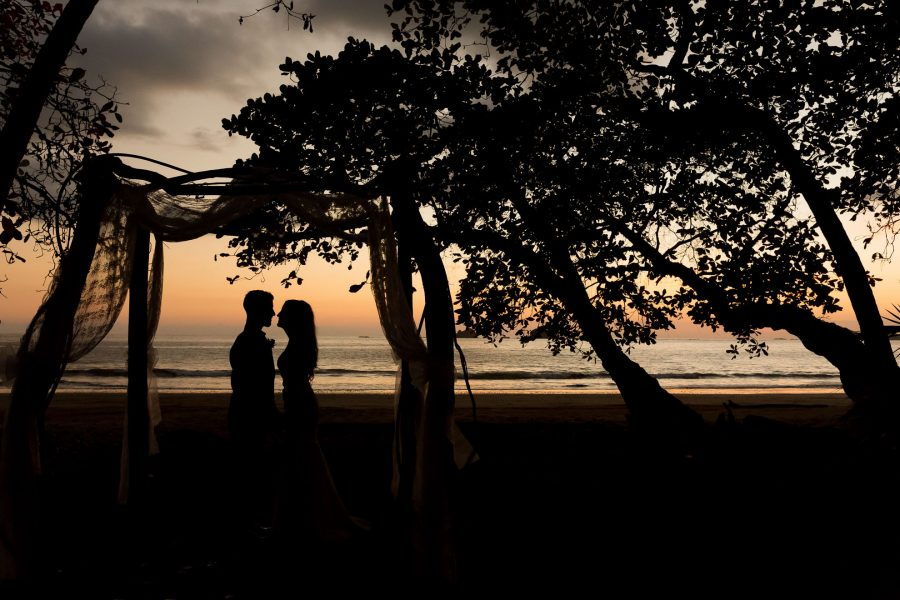 Bride and groom beach silhouette at sunset