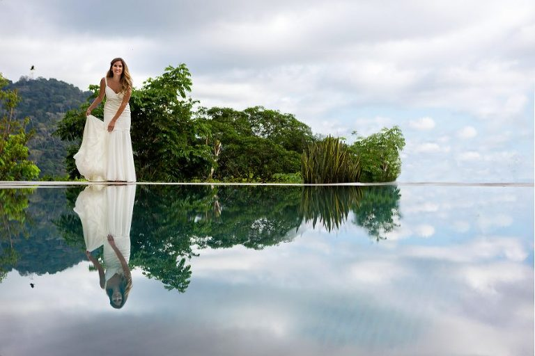 Bride reflection in infinity pool