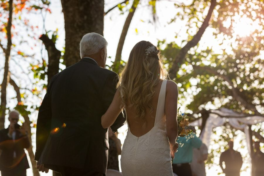 Bride being walked down the aisle by father