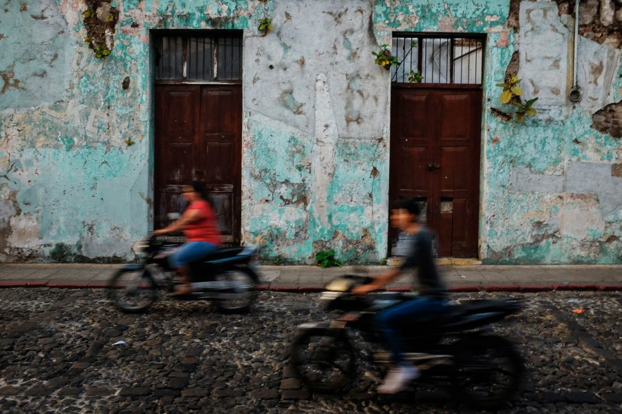 Old walls in antigua guatemala with motos