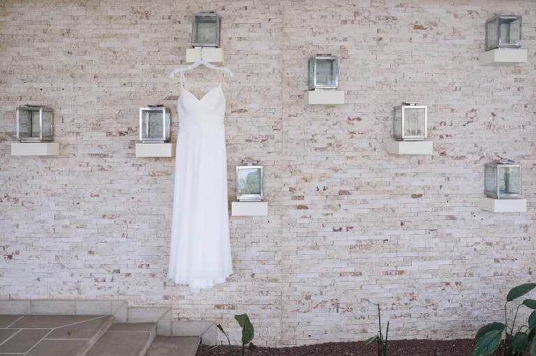 The dress hanging in front of an artistic wall in Villa Paraiso, Tamarindo, Costa Rica